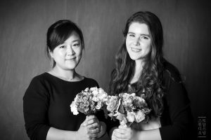portrait of Addie and her host mom with bouquets