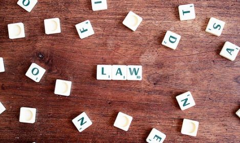law spelled out in Scrabble tiles