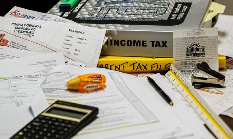 tax books, papers, and calculator