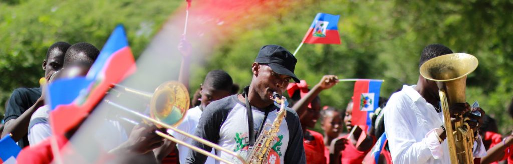 marching band with Haitian flags
