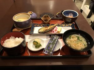 Japanese meal with several bowls on a tray