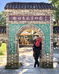 Nabila standing in an archway