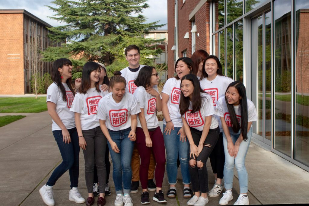 Project Pengyou group photo of students in matching tee shirts