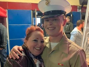 Jami in uniform with his arm around his mother