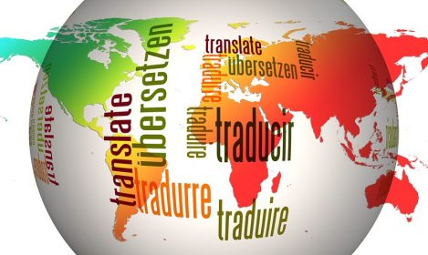"""globe with words for """"translate"""" in different languages written over it"""