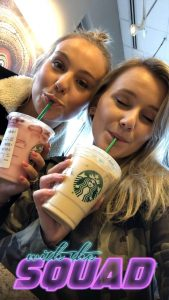 "Merrill and her German friend sipping Starbucks drinks with the caption ""with the squad"""