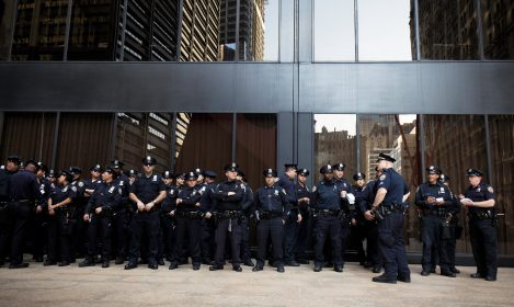 police officers in front of a building