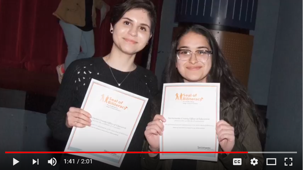 Two young women with Seal of Biliteracy certificates