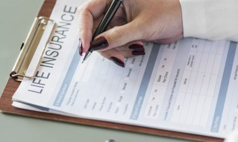 life insurance forms on clipboard