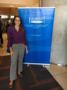 Jacinta standing with a Fulbright banner