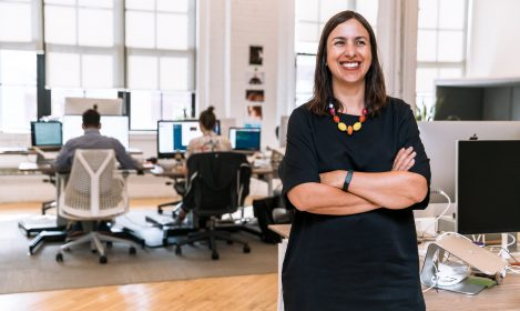 business woman in a tech office, smiling