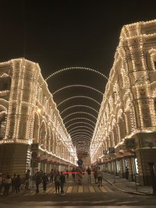 Russian city street lined with white holiday lights
